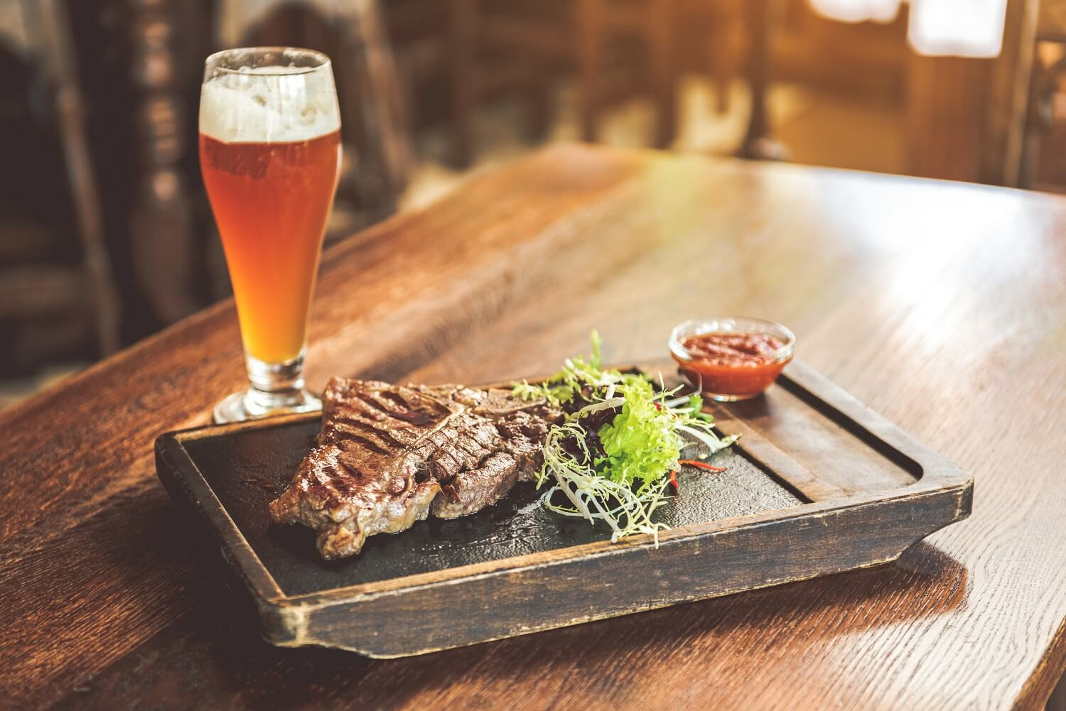 steak dish and beer